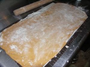 rolled-out-pumpkin-cinnamon-roll-dough