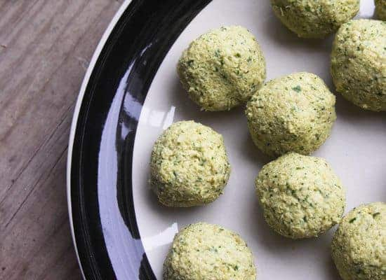 falafel balls before frying on a black and white plate