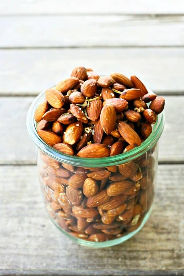 Slow Roasted Rosemary Garlic Almonds are an easy, healthy snack for warm weather months.