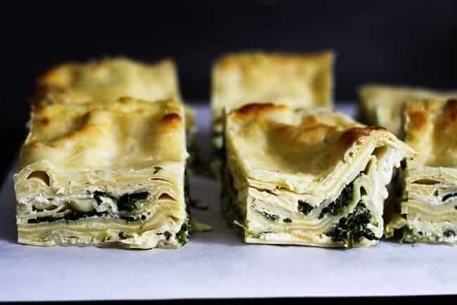 Roasted Garlic Spinach Alfredo Lasagna cut into servings to be frozen from Foodie with Family