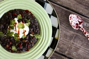 A bowl of Brazilian Black Bean and Sweet Potato Stew | www.foodiewithfamily.com