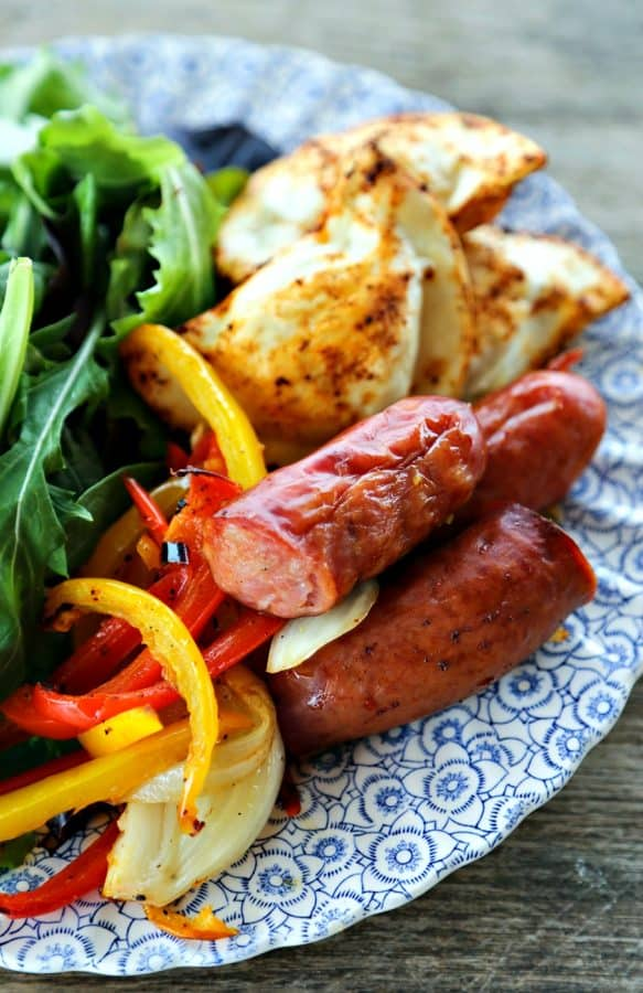 Kielbasa and Pierogies Sheet Pan Meal with juicy roasted kielbasa, crisp tender peppers and onions and puffy, potato filled pierogies.