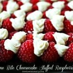 One Bite Cheesecake Stuffed Rasperries with Chambord foodiewithfamily.com #cheesecake #Dessert