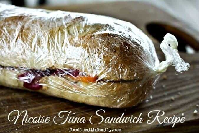 Nicoise Tuna Sandwich Recipe olives, peppers, albacore tuna, hardboiled eggs, albacore tuna, baguette. foodiewithfamily.com