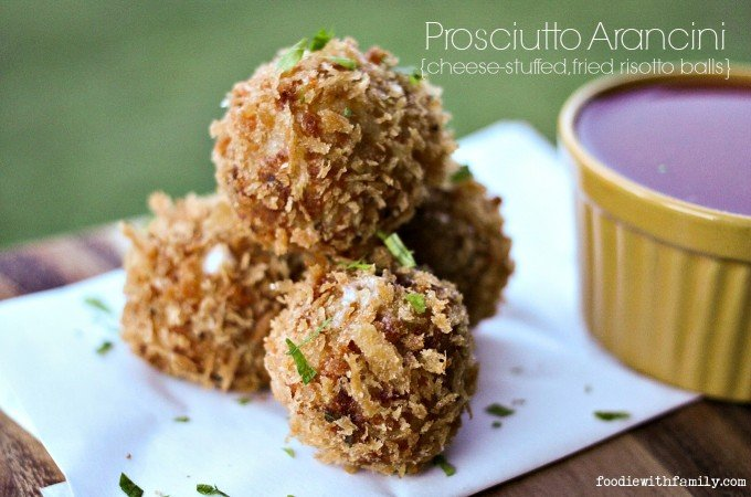 Prosciutto Arancini {crispy cheese-stuffed, fried risotto balls} from foodiewithfamily.com