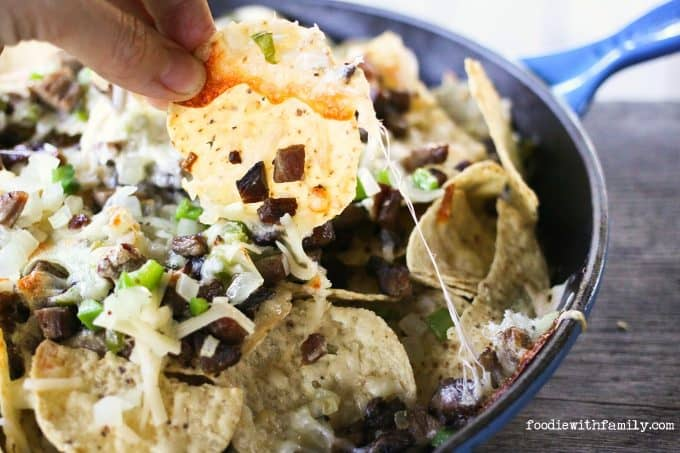 Beef, cheese, onions, peppers, and chips, Cheesesteak Nachos are comfort food deluxe from foodiewithfamily.com