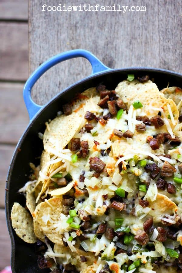 Cheesesteak Nachos are comfort food deluxe from foodiewithfamily.com beef, cheese, onions, peppers