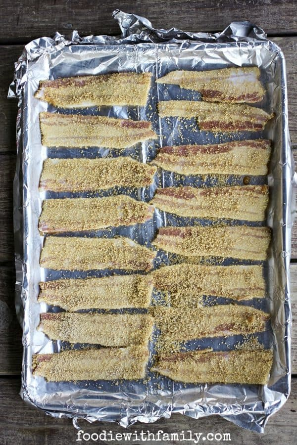 Homemade Maple Candied Bacon being prepared for the oven by foodiewithfamily.com