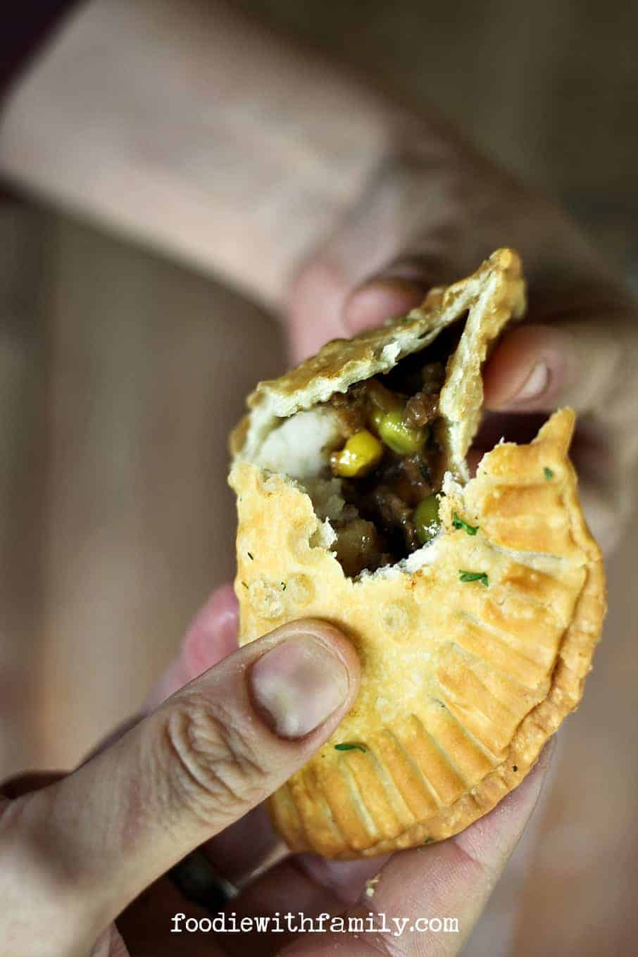 Shepherd's Pie Empanadas {beef, gravy, corn, peas, and mashed potato stuffed in a flaky, golden brown crust} from foodiewithfamily.com