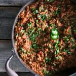 Tex Mex Mash: smashed pinto beans, seasoned browned ground beef, and crispy bacon simmered in a garlicky, chipotle tomato sauce from foodiewithfamily.com