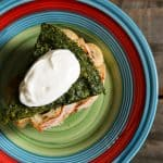 Plain yogurt garnishing Persian Herb Frittata a.k.a. Kookoo Sabzi from foodiewithfamily.com