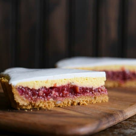 Rhubarb Custard Pie starts with a simple crumb crust that is filled with a tart and sweet rhubarb vanilla filling covered by thin layer of cheesecake and topped with a smooth-as-silk tangy yogurt layer. It's spring and summer perfection, folks.