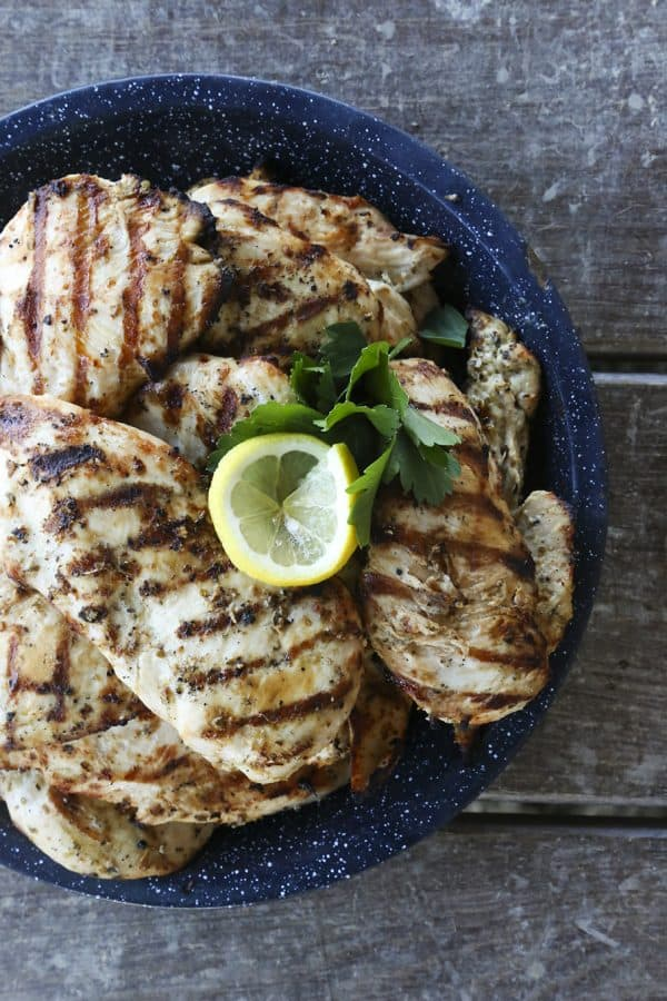 Juicy, grilled Greek Lemon Garlic Chicken from foodiewithfamily.com