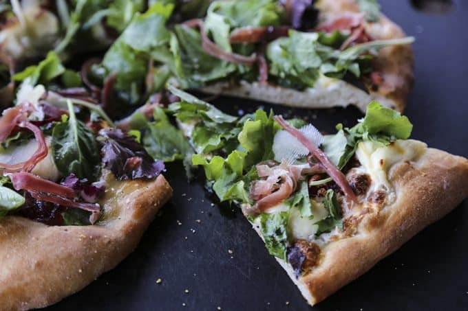 Figgy Pig Pizza - Tuscan Style Prosciutto, fig jam, and greens pizza from foodiewithfamily.com #client #DaVinciStorytellerFiggy Pig Pizza - Tuscan Style Prosciutto, fig jam, and greens pizza from foodiewithfamily.com #client #DaVinciStoryteller