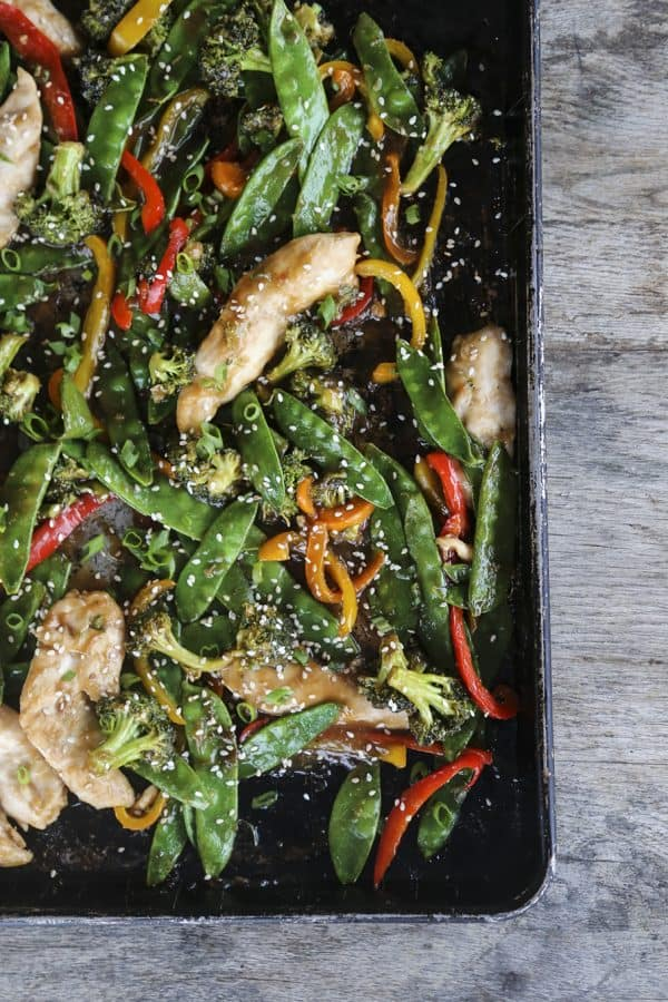Fabulously fast, filling, and flavourful, this Asian Chicken Stir Fry Sheet Pan Meal will please everyone and feed a crowd economically.