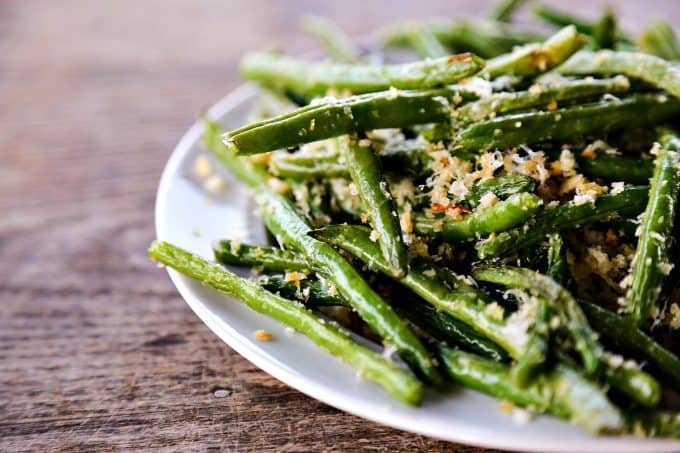 Garlic Parmesan Green Beans: Simple roasted green beans irresistibly coated in crispy garlic, parmesan breadcrumbs.