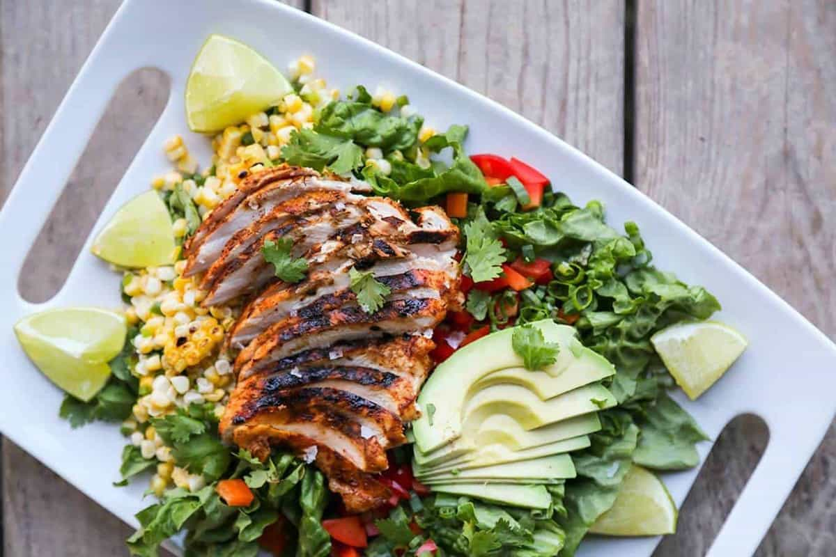 Super tasty, super simple, Spicy Southwestern Chicken Salad and Meal Prep Bowls: This three-for-one gives you an amazing batch of Spicy Southwestern Chicken, a dinner salad recipe using the chicken, and meal prep bowls using both the Chicken and the Salad!