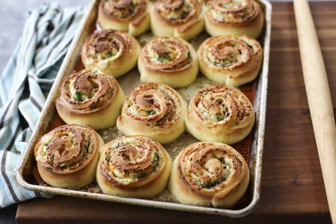 Hot Ham and Cheese Rolls: best bread dough wrapped around smoky ham, piles of Cheddar cheese, and green onions, sliced, and baked to tender perfection.