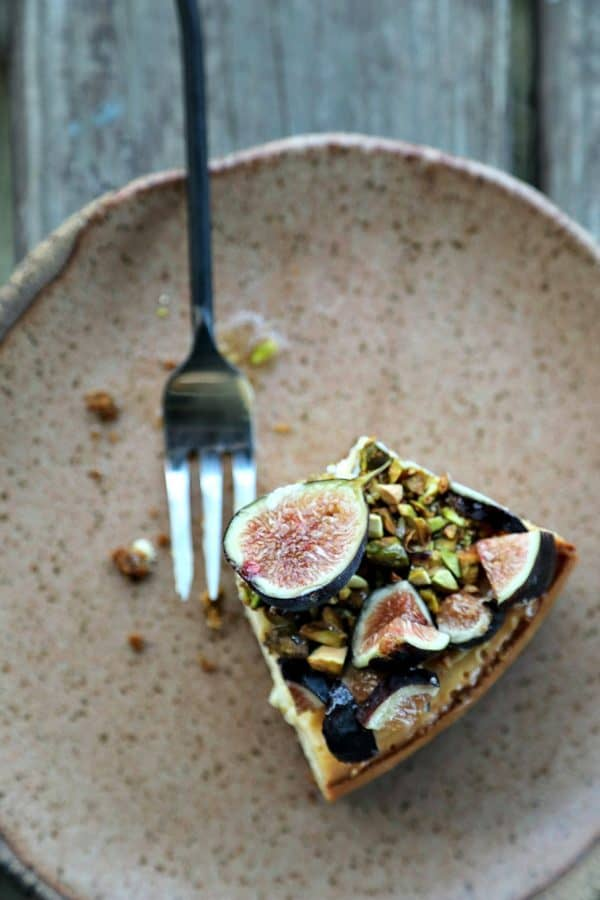 Ultra-creamy, not too sweet, and a feast-for-the-eyes while still being simple to make, this vanilla bean flecked Fig Pistachio Honey Goat Cheese Cheesecake is a show stopper!