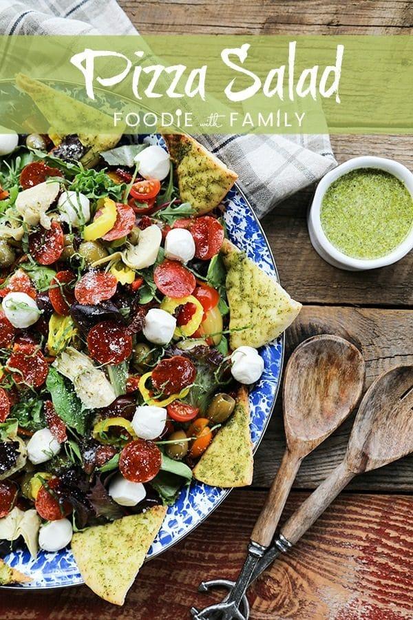 Supreme Pizza Salad: this salad is no boring, average salad. Mixed greens are tossed with crisped pepperoni, pesto pita chips, artichoke hearts, mini mozzarella balls, marinated olives, cherry tomatoes, sun dried tomatoes, pepperoncini, and a flavourful pesto vinaigrette.