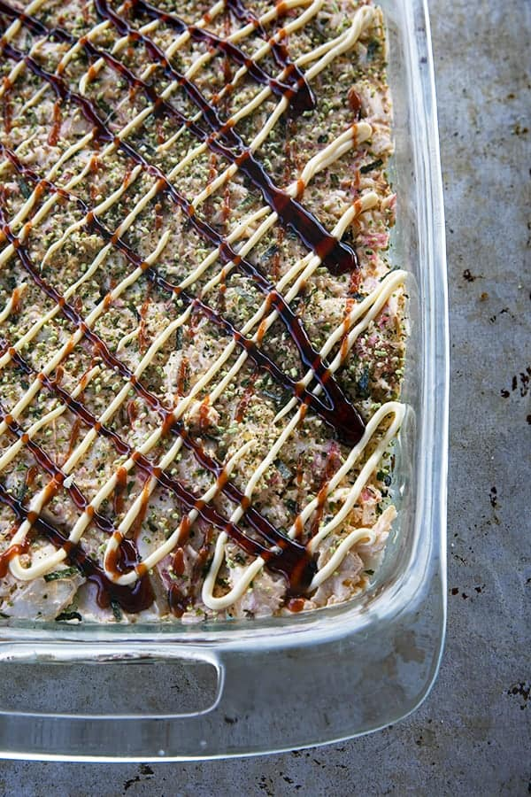 Sushi Bake ready to go into the oven with sauce.