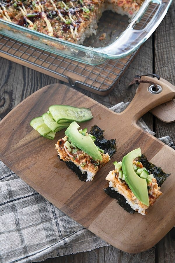 Sushi Bake rice topped with creamy crab layer and sauce serve on toasted nori