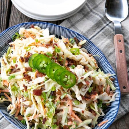 Jalapeno Coleslaw is a deliciously fresh, crunchy, savoury, summery salad to accompany all your grilled main dishes. Creamy, tangy, and easily adjustable to suit your heat-preferences, this super fresh spicy coleslaw is one you'll reach for again and again.