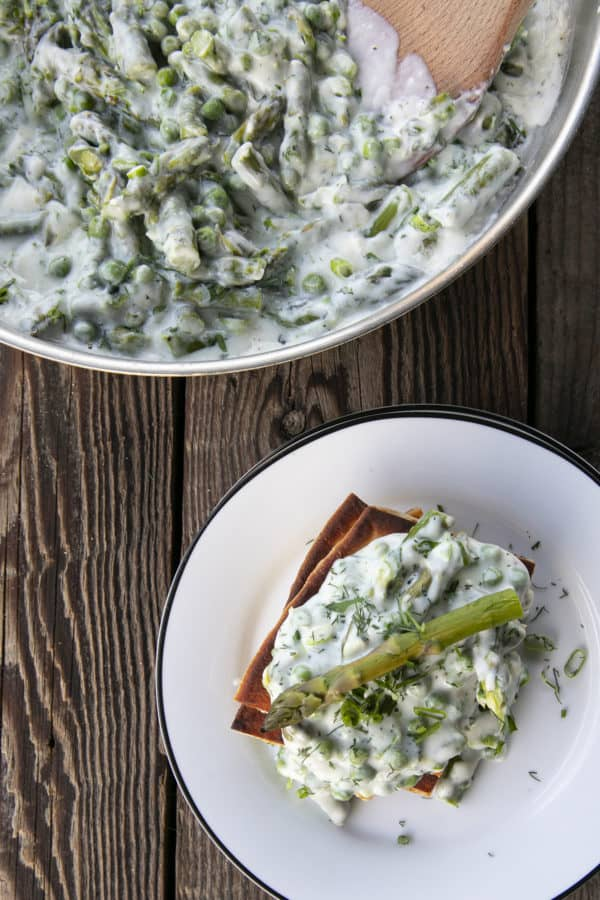 Tender spring peas and asparagus combine in a garden herb cream sauce in this new-fashioned take on delightfully old-fashioned Creamed Peas. Served over toast, this is one simple, economical dish wows!