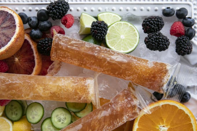 Pimm's Cup Recipe boozy popsicles are made of a gin-based liqueur, fizzy Prosecco, a hint of lemon and strawberry puree, and are guaranteed to refresh you!