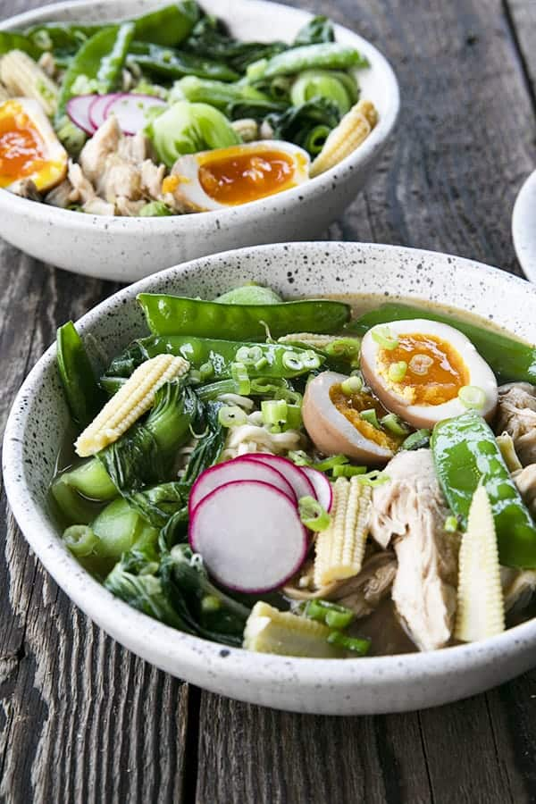 Instant Pot Chicken Ramen with jammy egg, baby corn, pea pods, bok choy, mushrooms, and radishes.