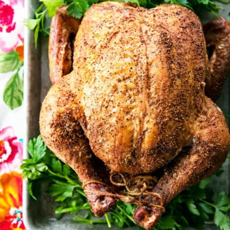 You will never believe how easy and spectacular this smoked whole chicken recipe is until you try it yourself. Full of tips and tricks, this post will help you make the best smoked chicken recipe you've ever had in your life!