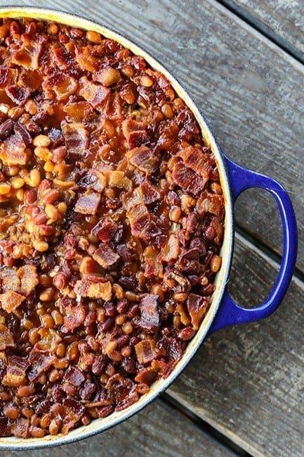 Barbecue Bacon Spicy Baked Beans are chock full of browned pork sausage, bacon, and enough spicy barbecue sauce to be so flavourful and so perfect that no one will ever believe these start with canned beans.
