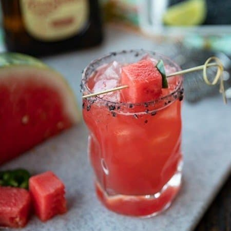 Pretty pink Watermelon Margaritas are refreshing, thirst quenching, lightly sweet and spicy cocktails for any time you need to cool down and chill out. Made vibrant with just 5 super fresh, all-natural ingredients, these are the ultimate way to relax!
