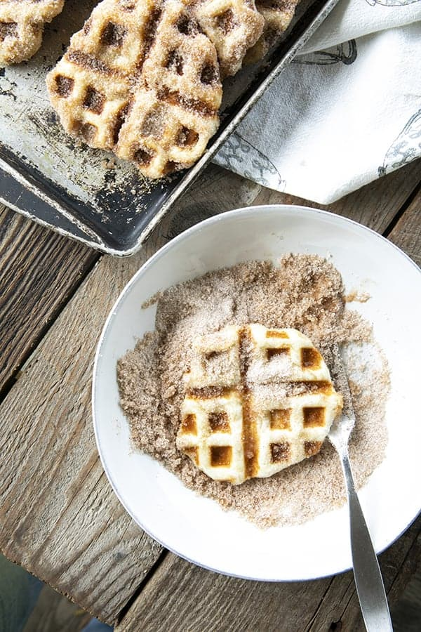 Crispy edged, cinnamon-sugar dusted Churros Waffles are 100% irresistible and ridiculously easy to make, taking advantage of frozen dough for the base. Bonus: No boiling oil!