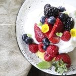 Ethereally light, crisp on the outside, marshmallowy on the inside, this Mini Pavlova Recipe is topped with lemon curd, berries, whipped cream, and ready for summer!