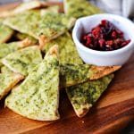 This crispy, crunchy, perfect pesto brushed homemade pita chips recipe is as easy as cut, brush, bake and makes a great snack or salad accompaniment.