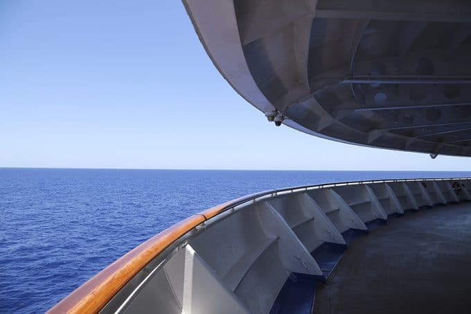 On the forward deck of the Caribbean Princess with Princess Cruises.