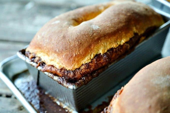 Pumpkin Cinnamon Swirl Bread is an irresistible golden-orange hued, soft, fine-crumbed bread with a decadent swirl of buttery cinnamon sugar.