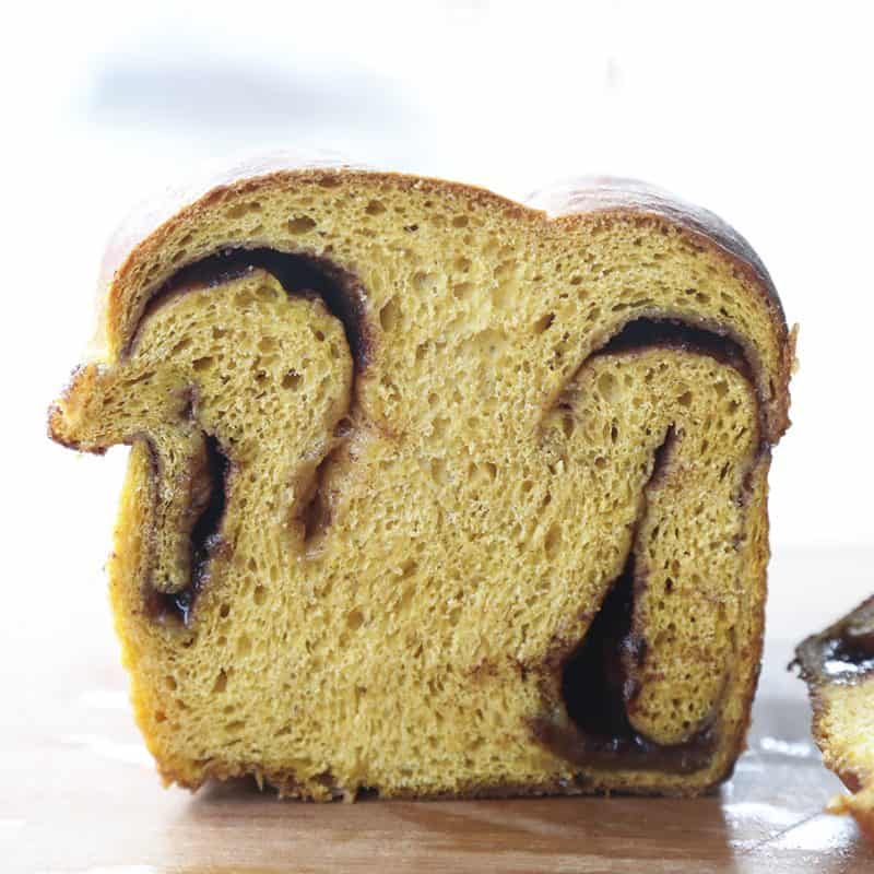 Pumpkin Cinnamon Swirl Bread is an irresistible golden-orange hued, soft, fine-crumbed bread with a decadent swirl of buttery cinnamon sugar.