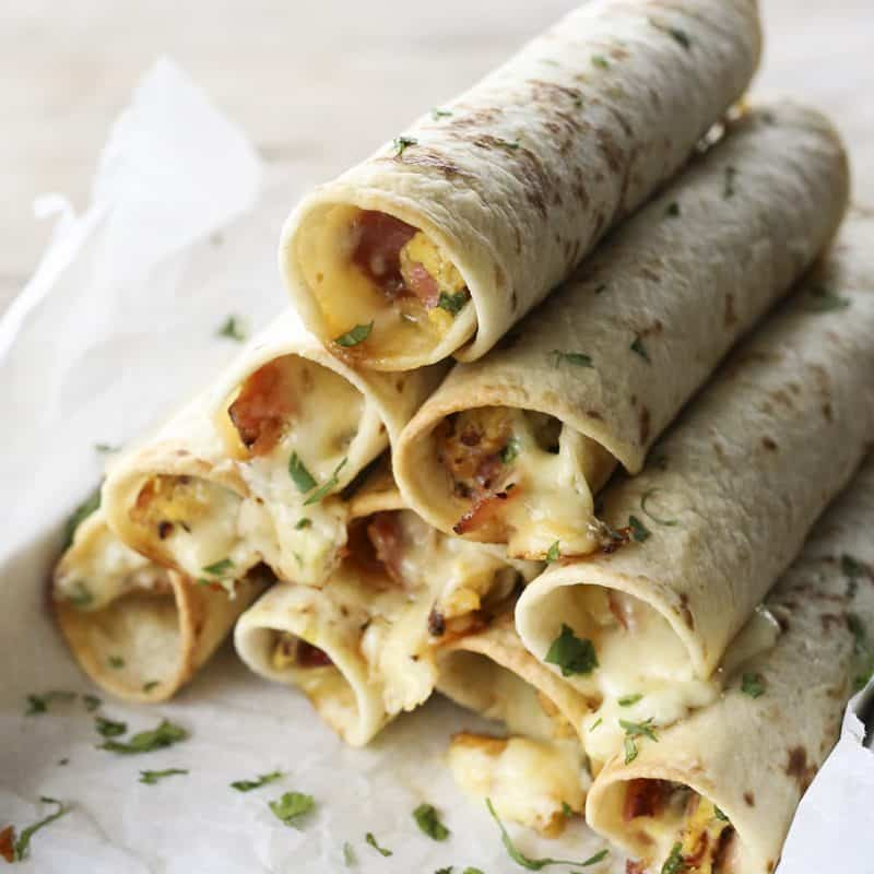 Baked Breakfast Taquitos with ham, eggs, pepperjack, and scallions.