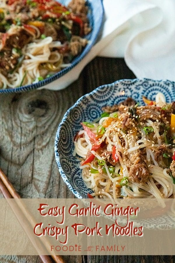 Easy Garlic Ginger Crispy Pork Noodles are going to be your new favourite dinner. Crazy simple. Crazier delicious. And easy on your pocketbook to boot. This delicious meal-in-one whips up in less than 30 minutes.