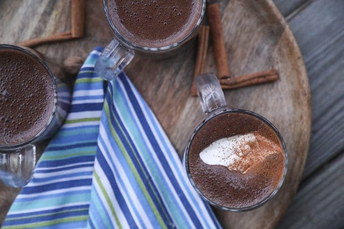 Creamy, rich, blender made spiced hot chocolate is made with just two main ingredients: good chocolate and milk. It has just a hint of warming cinnamon, nutmeg, and cayenne and is as easy as the powdered packets but worlds better.