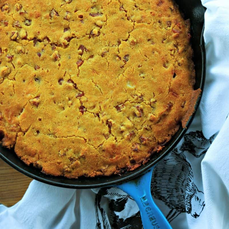 Toasty Ham Cheddar Onion Cornbread is buttermilk cornbread bursting with golden brown ham cubes, caramelized onions, and pockets of melted Cheddar cheese.