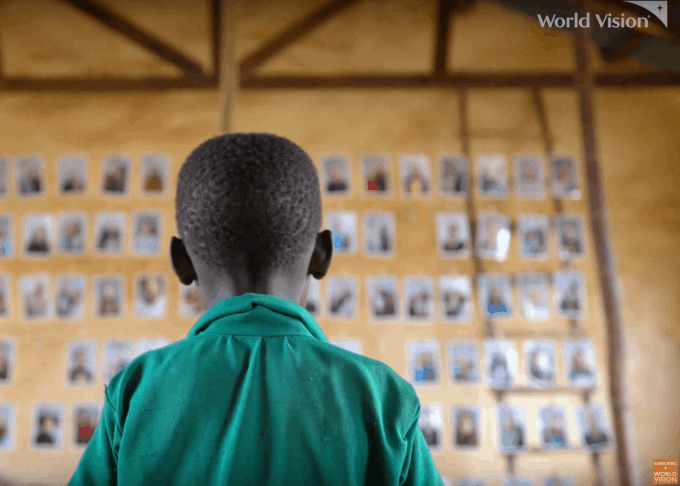 A Child looking at potential sponsors to choose through World Vision's Chosen program.